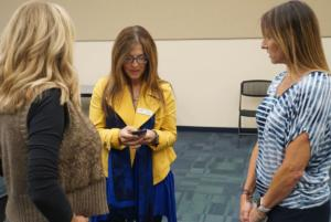 COSF Directors Janna Williams and Marcella Ketelhut talk to presenter Aly Covingtion, on the right.