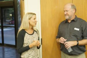 COSF Director Kira Krukowski talks to COSF President Jerry Westby before the event.