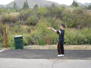 A disc golfer tees up.