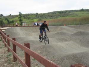 On the pump track. This fellow really should be wearing a helmet.