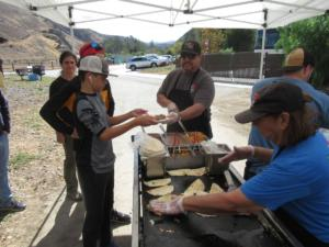 Serving up tacos for the volunteers as thank-you for their hard work in preparing the trails for upciming winter rains